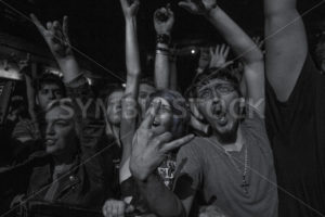 BOISE, IDAHO – FEBRUARY 15, 2015: Gritty picture of fans during the Miss May I show at the knitting factory - Shot Your show