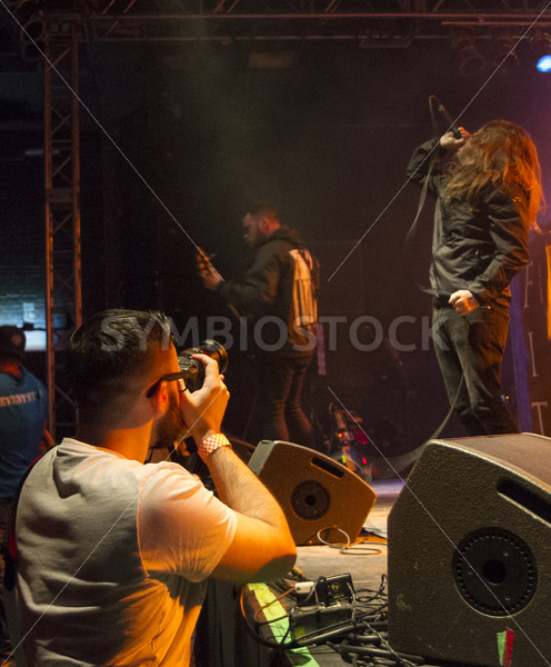 BOISE, IDAHO – FEBRUARY 15, 2015:Photographer catching the action during the Fit for a King perfornace - Shot Your show