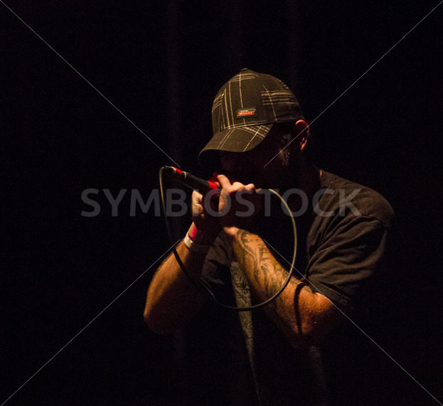 BOISE, IDAHO/USA – JANUARY 24, 2015: lead singer of Rise of the Fallen against a dark background singing - Shot Your show