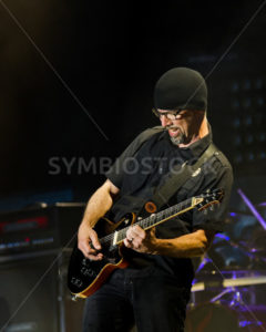 NAMPA, IDAHO - SEPTEMBER 25: Tony Rombola, guitarist from Godsmack, plays an intense moment on his guitar at the Rockstar Uproar Festival on September 25 2012 in Nampa, Idaho - Shot Your show