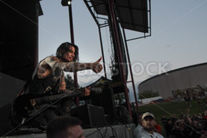 NAMPA, IDAHO - SEPTEMBER 5: After giving his pick to a membe of the crowd Janes Addiction Guitarist Dave Navarro gives a thumbs up at Uproar Festival in Nampa, Idaho September 5th, 2013 - Shot Your show