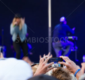 NAMPA, IDAHO/USA - JUNE 16, 2016: Person trying to photograph The Band Perry show in Nampa at the Idaho Center - Shot Your show