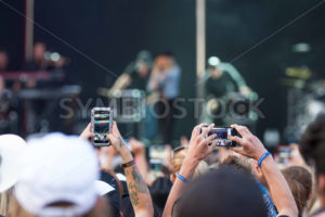 NAMPA, IDAHO/USA - JUNE 16, 2016: The crowd takes pictures of The Band Perry Show in Nampa at the Idaho Center - Shot Your show