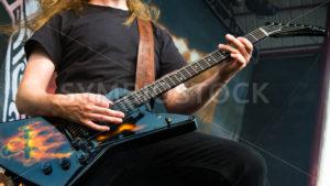 NAMPA/IDAHO - JULY 2: Johan S?derberg from Amon Amarth showing his guitar during the Rockstar Mayhem Festival in Nampa, Idaho on July 2nd, 2013 - Shot Your show