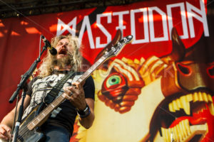 NAMPA/IDAHO - JULY 2: Troy Sanders from mastodon providing backup vocals while playing his jaguar bass guitar at the Rockstar Mayhem Festival in Nampa, Idaho July 2nd, 2013 - Shot Your show