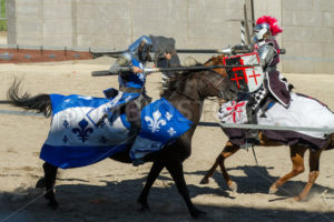 BOISE, IDAHO – AUGUST 19: Close call between the blue knight and the red knight while jousting at the Idaho Fair in Boise, Idaho on August 19, 2012 - Shot Your show