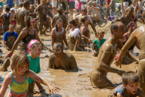 BOISE, IDAHO – AUGUST 25: Crowd gathered in the mud pit at the Dirty Dash August 25 2012 in Boise, Idaho - Shot Your show