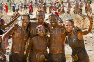 BOISE, IDAHO – AUGUST 25: Group poses for a photo at the Dirty Dash August 25 2012 in Boise, Idaho - Shot Your show