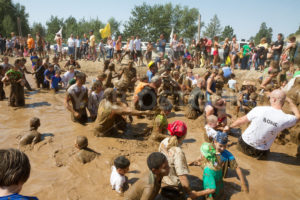 BOISE, IDAHO – AUGUST 25: People play in the pond of mud at the Dirty Dash August 25 2012 in Boise, Idaho - Shot Your show