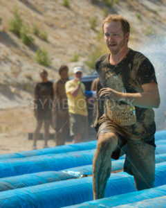BOISE, IDAHO – AUGUST 25: Runner 14638 going fast on the slide at the Dirty Dash August 25 2012 in Boise, Idaho - Shot Your show