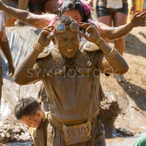 BOISE, IDAHO – AUGUST 25: Runner 14701 lifts his goggles at the Dirty Dash August 25 2012 in Boise, Idaho - Shot Your show