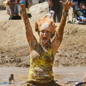 BOISE, IDAHO – AUGUST 25: Runner 14959 is excited at completing the Dirty Dash August 25 2012 in Boise, Idaho - Shot Your show