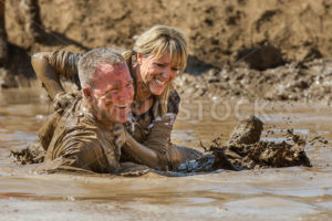 BOISE, IDAHO – AUGUST 25: Runners at the Dirty Dash splash in the mud on August 25 2012 in Boise, Idaho - Shot Your show