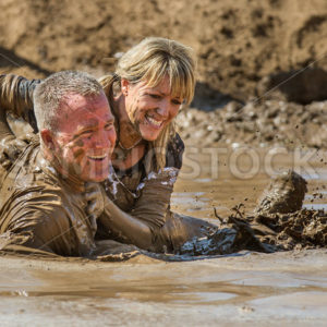BOISE, IDAHO – AUGUST 25: Runners at the Dirty Dash splash in the mud on August 25 2012 in Boise, Idaho - Shot Your show