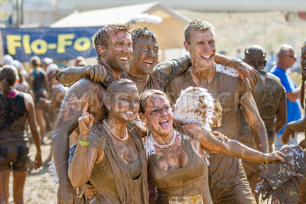 BOISE, IDAHO – AUGUST 25: Runners stop and pose for a picture at the Dirty Dash August 25 2012 in Boise, Idaho - Shot Your show