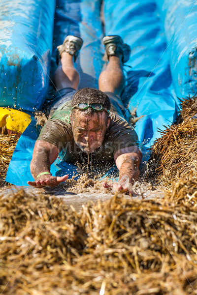 BOISE, IDAHO – AUGUST 25: Unidentified man at the bottom of the slide at the Dirty Dash August 25 2012 in Boise, Idaho - Shot Your show