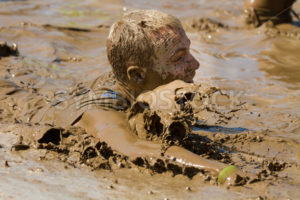 BOISE, IDAHO – AUGUST 25: Unidentified man splashes in the pool at the Dirty Dash August 25 2012 in Boise, Idaho - Shot Your show