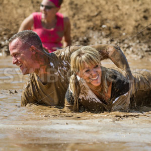 BOISE, IDAHO – AUGUST 25: Unidentified people play in the mud at the Dirty Dash August 25 2012 in Boise, Idaho - Shot Your show