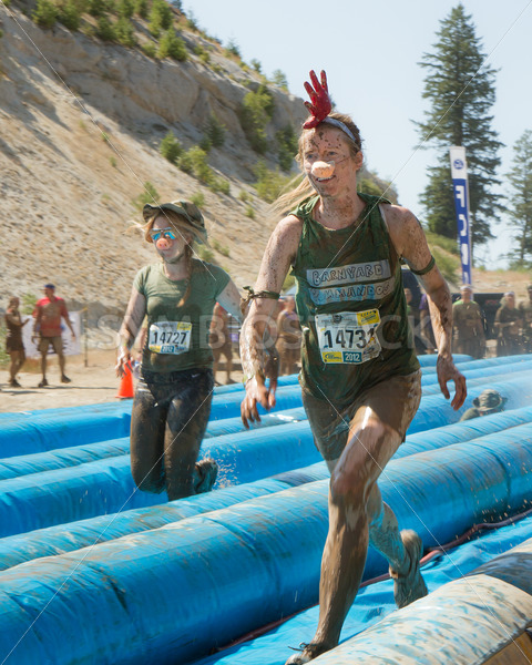 BOISE, IDAHO – AUGUST 25: Unidentified people run down the slides at the Dirty Dash August 25 2012 in Boise, Idaho - Shot Your show