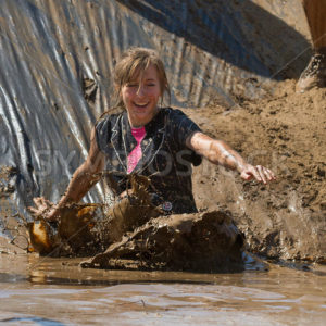 BOISE, IDAHO – AUGUST 25: Unidentified woman makes a spash at the bottom of the slide during the Dirty Dash August 25 2012 in Boise, Idaho - Shot Your show