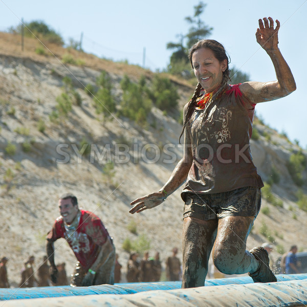 BOISE, IDAHO – AUGUST 25: Unidentified woman runs at the Dirty Dash August 25 2012 in Boise, Idaho - Shot Your show
