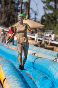 BOISE, IDAHO – AUGUST 25: Unidentified woman runs down the slide at the Dirty Dash August 25 2012 in Boise, Idaho - Shot Your show