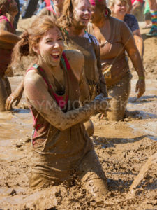 BOISE, IDAHO – AUGUST 25: Unidentified woman runs through the mud at the Dirty Dash August 25 2012 in Boise, Idaho - Shot Your show