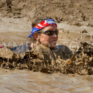 BOISE, IDAHO – AUGUST 25: Unidentified woman swims in the muck and mud at the Dirty Dash August 25 2012 in Boise, Idaho - Shot Your show