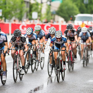 BOISE, IDAHO – JULY 14: Pack of riders racing through the straight at the Boise Twilight Criterium in Boise, Idaho on July 14, 2012 - Shot Your show