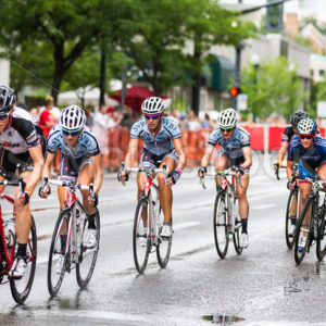 BOISE, IDAHO – JULY 14: Riders racing down the track in the rain the Boise Twilight Criterium in Boise, Idaho on July 14, 2012 - Shot Your show