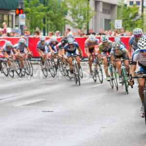 BOISE, IDAHO – JULY 14:Large pack of racers go around one of the turns at the Boise Twilight Criterium in Boise, Idaho on July 14, 2012 - Shot Your show