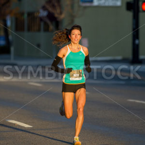 BOISE, IDAHO – NOVEMBER 22: Runner 928 runs to the finish line during the Turkey Day 5k in Boise, Idaho on November 22, 2012 - Shot Your show