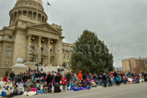 BOISE, IDAHO - NOVEMBER 24: A crowd gathers at the bottom of the boise capital building to watch the Boise Holiday Parade on November 24, 2012 - Shot Your show