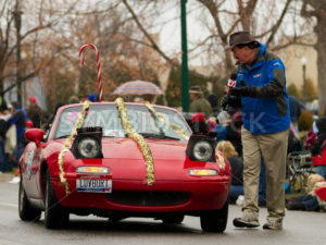 BOISE, IDAHO - NOVEMBER 24: Larry Gebert from KTVB gives an interview during the Boise Holiday Parade on November 24, 2012 - Shot Your show