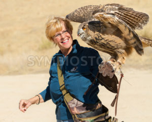 BOISE, IDAHO - OCTOBER 7 : Unidentified trainer at World Center for the Birds of Prey handles a Eurasian Eagle-owl on October 7th, 2012. - Shot Your show