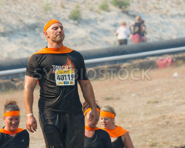 BOISE, IDAHO/USA – AUGUST 10: MAn 40119 stands with his superhero cape at the The Dirty Dash in Boise, Idaho on August 10, 2013 - Shot Your show
