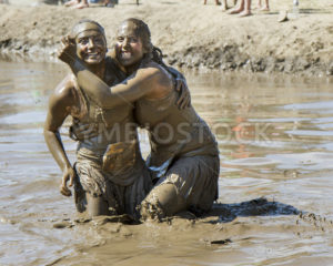 BOISE, IDAHO/USA – AUGUST 11, 2013: Two friends pose for a photo at the dirty dash in Boise, Idaho - Shot Your show