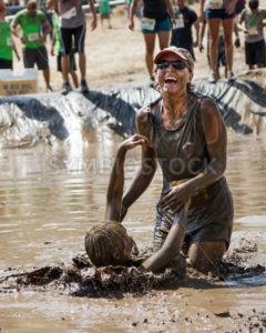 BOISE, IDAHO/USA – AUGUST 11, 2013: Two unidentified people splash and smile at the dirty dash - Shot Your show