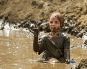 BOISE, IDAHO/USA – AUGUST 11, 2013: Unidentified child plays with the mud at the dirty dash - Shot Your show