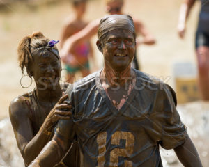 BOISE, IDAHO/USA – AUGUST 11, 2013: Unidentified man and woman full of smiles after competing in the dirty dash - Shot Your show