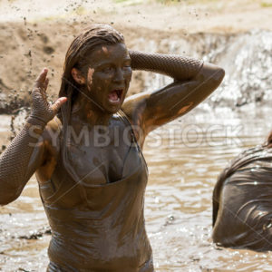 BOISE, IDAHO/USA – AUGUST 11, 2013: Unidentified woman screams as she is covered in mud at the dirty dash - Shot Your show