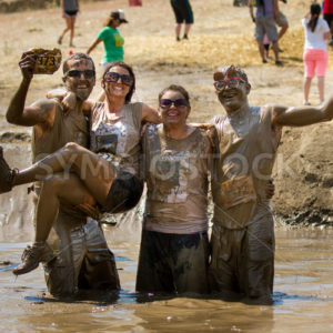 BOISE, IDAHO/USA – AUGUST 11, 2013:group of people near the finish proud of their success at The Dirty Dash in Boise, Idaho - Shot Your show
