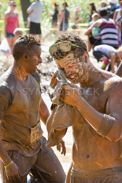 BOISE, IDAHO/USA – AUGUST 25 – A Man who is unidentified trying to clean up after participating in the Dirty Dash. The Dirty dash is a 10k run through obstacles and mud on August 25, 2012 in Boise, Idaho - Shot Your show