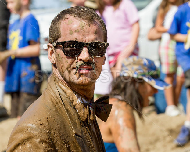 BOISE, IDAHO/USA – AUGUST 25 – Unidentified man wearing mustache glasses and a suite during the dirty dash  The Dirty dash is a 10k run through obstacles and mud on August 25, 2012 in Boise, Idaho - Shot Your show
