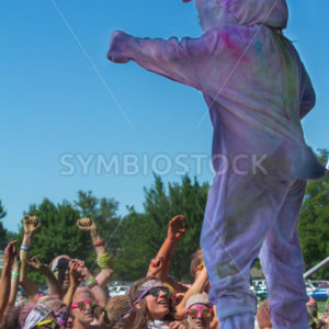 BOISE, IDAHO/USA – JUNE 22: A dressed up rabbit talks to the crowd after The Color Me Rad 5k in boise on June 22, 2013 - Shot Your show