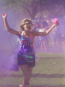 BOISE, IDAHO/USA – JUNE 22: Runner 13446 just got color bombed at the Color Me Rad 5k in boise on June 22, 2013 - Shot Your show