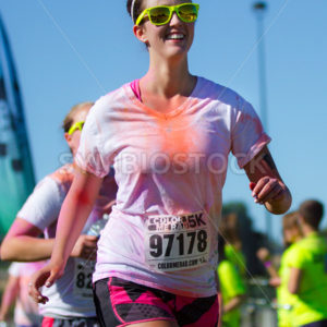 BOISE, IDAHO/USA – JUNE 22: Runner 97178 is walking their way to the finish at the Color Me Rad 5k in boise on June 22, 2013 - Shot Your show