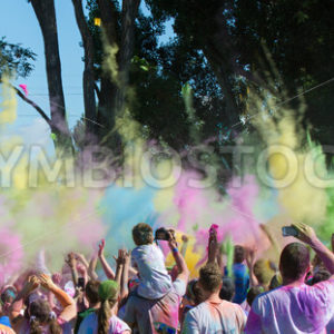 BOISE, IDAHO/USA – JUNE 22: The crowd throws up their color bombs into the air during the Color Me Rad 5k in boise on June 22, 2013 - Shot Your show