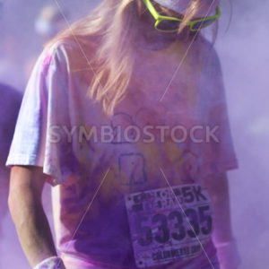 BOISE, IDAHO/USA – JUNE 22: Unidentified man standing in the color spray at the Color Me Rad 5k in boise on June 22, 2013 - Shot Your show