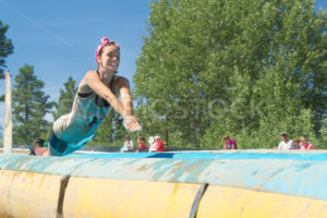 BOISE, IDAHO/USA - AUGUST 10, 2013: An unidentified woman dives down the slide at the The Dirty Dash - Shot Your show
